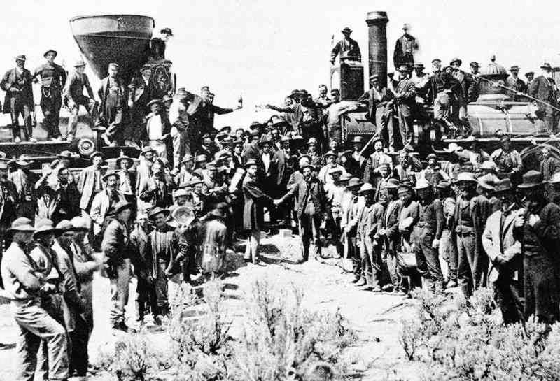 The ceremonial driving of the golden spike - Promontory Summit, Utah, May 10, 1869. Photograph - Andrew J. Russell. Image from Wikipedia